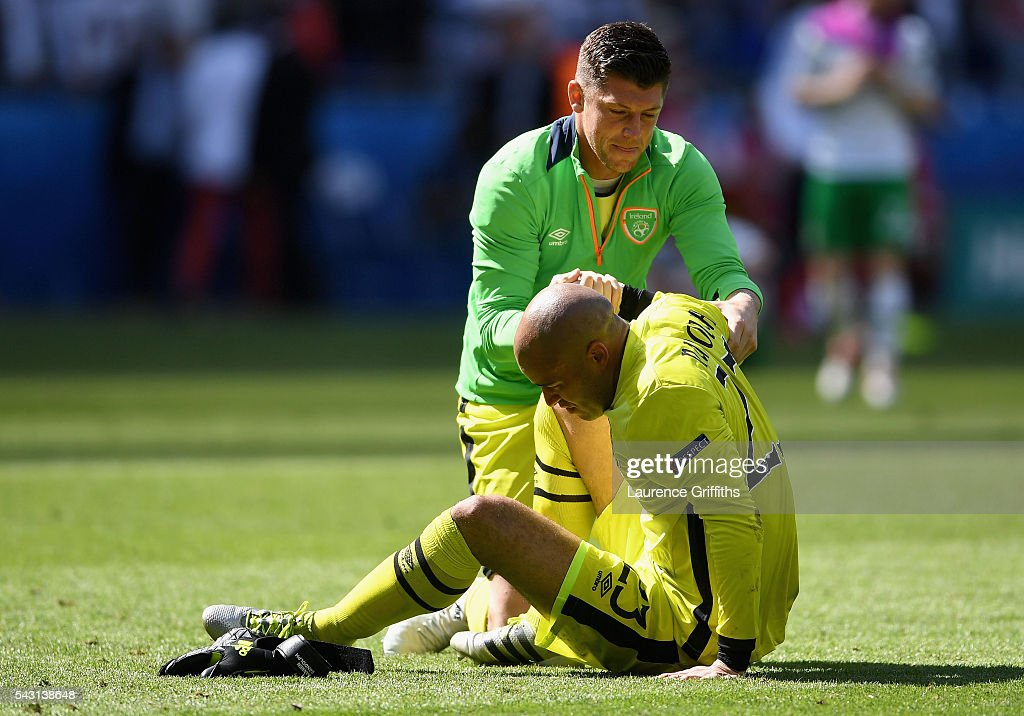 <a gi-track='captionPersonalityLinkClicked' href=/galleries/search?phrase=Darren+Randolph&family=editorial&specificpeople=3947785 ng-click='$event.stopPropagation()'>Darren Randolph</a> (R) of Republic of Ireland is consoled by <a gi-track='captionPersonalityLinkClicked' href=/galleries/search?phrase=Keiren+Westwood&family=editorial&specificpeople=3949539 ng-click='$event.stopPropagation()'>Keiren Westwood</a> (L) after their team's 1-2 defeat in the UEFA EURO 2016 round of 16 match between France and Republic of Ireland at Stade des Lumieres on June 26, 2016 in Lyon, France.