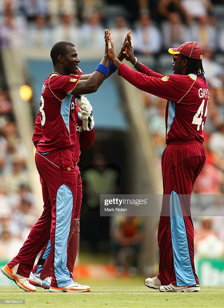 Darren Sammy and Chris Gale of the West Inides celebrate a wicket during the Commonwealth Bank One Day International Series between Australia and the West Indies at Manuka Oval on February 6, 2013 in Canberra, Australia.
