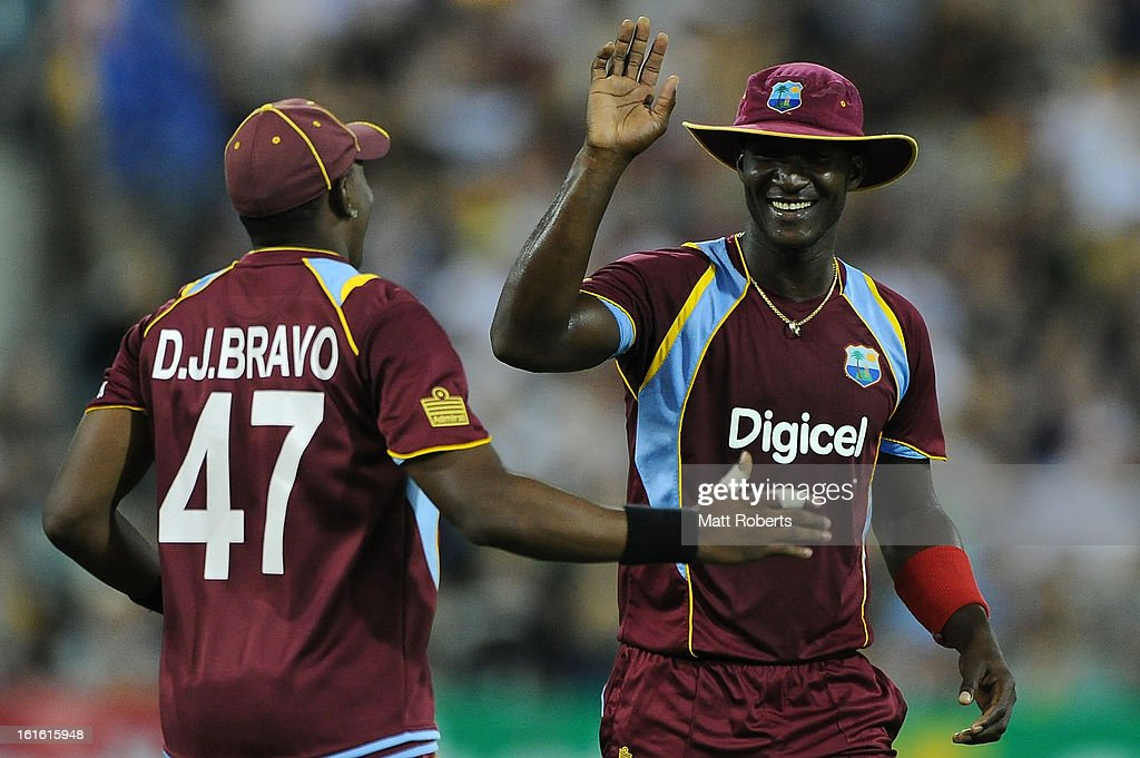 Darren Sammy (R) and Dwayne Bravo of the West Indies share a laugh after a a dropped catch during the International Twenty20 match between Australia and the West Indies at The Gabba on February 13, 2013 in Brisbane, Australia.