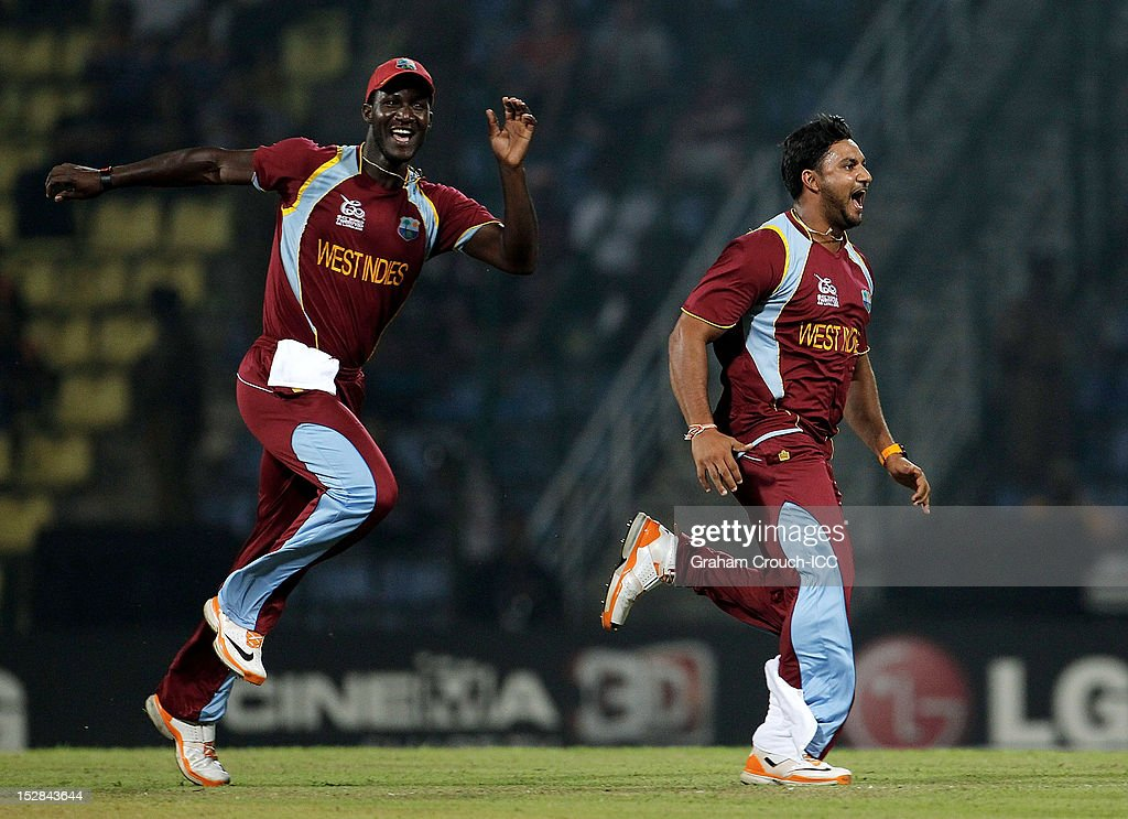<a gi-track='captionPersonalityLinkClicked' href=/galleries/search?phrase=Darren+Sammy&family=editorial&specificpeople=2920912 ng-click='$event.stopPropagation()'>Darren Sammy</a> and <a gi-track='captionPersonalityLinkClicked' href=/galleries/search?phrase=Ravi+Rampaul&family=editorial&specificpeople=2924536 ng-click='$event.stopPropagation()'>Ravi Rampaul</a> of West Indies celebrate the wicket of Luke Wright of England during the A1 versus B2 Super Eight match between England and West Indies at Pallekele Cricket Stadium on September 27, 2012 in Kandy, Sri Lanka.