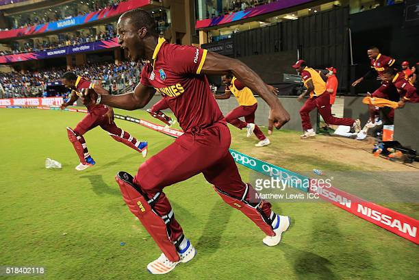 Darren Sammy Captain of the West Indies celebrates his teams win over India during the ICC World Twenty20 India 2016 SemiFinal match between West...