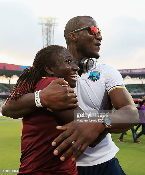 Darren Sammy Captain of the West Indies congratulates Stafanie Taylor Captain of the West Indies on her teams win over Australia during the Women's...