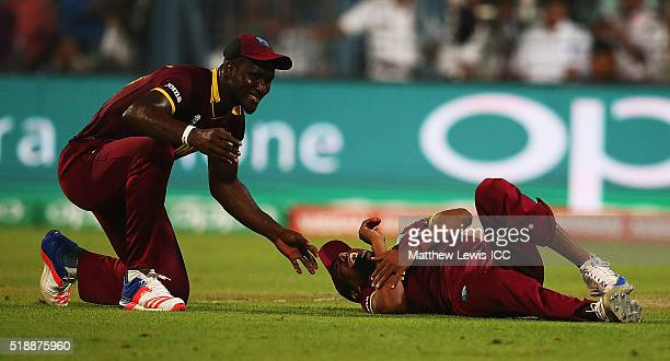 Darren Sammy Captain of the West Indies looks on after Samuel Badree of the West Indies injures himself catching Liam Plunkett of England during the...