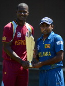 Darren Sammy captain of West Indies Mahela Jayawardene captain of Sri Lanka pose with the ICC World T20 trophy ahead of the 2012 ICC World Twenty20...