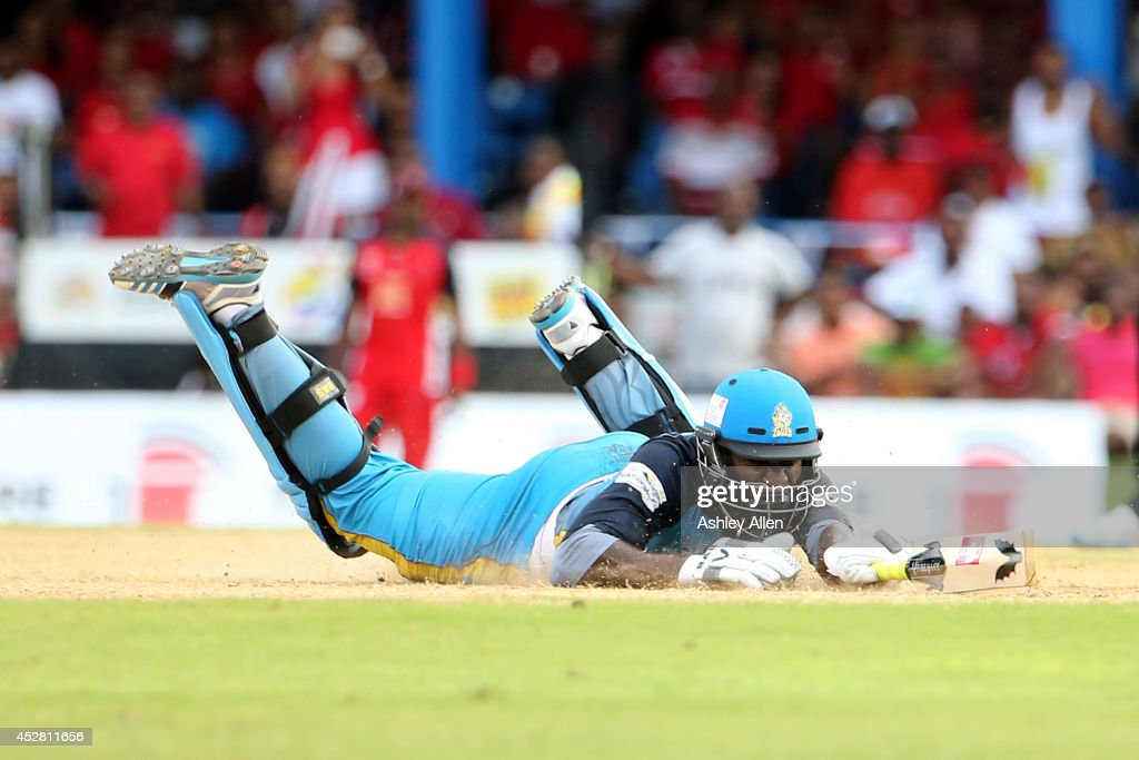 <a gi-track='captionPersonalityLinkClicked' href=/galleries/search?phrase=Darren+Sammy&family=editorial&specificpeople=2920912 ng-click='$event.stopPropagation()'>Darren Sammy</a> dives during a match between The Trinidad and Tobago Red Steel and St. Lucia Zouks as part of the week 3 of Caribbean Premier League 2014 at Queen's Park Oval on July 27, 2014 in Port of Spain, Trinidad & Tobago.