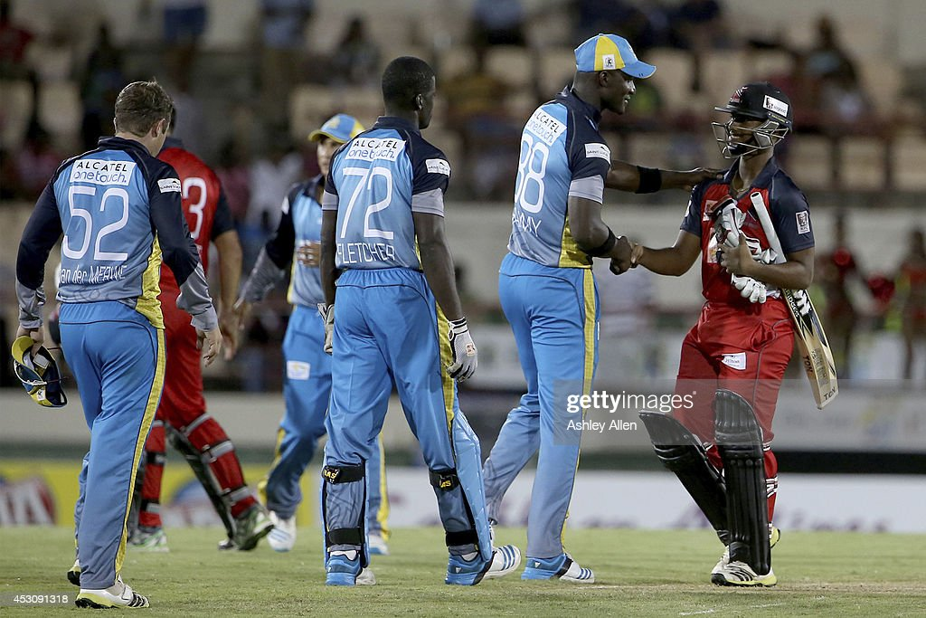 Darren Sammy (L) of St. Lucia Zoucks congratulates Nicholas Pooran (R) of The Red Steel after loosing a match between The Red Steel and St. Lucia Zouks as part of week 4 of the Limacol Caribbean Premier League 2014 at Beausejour Stadium on August 02, 2014 in Castries, St. Lucia.