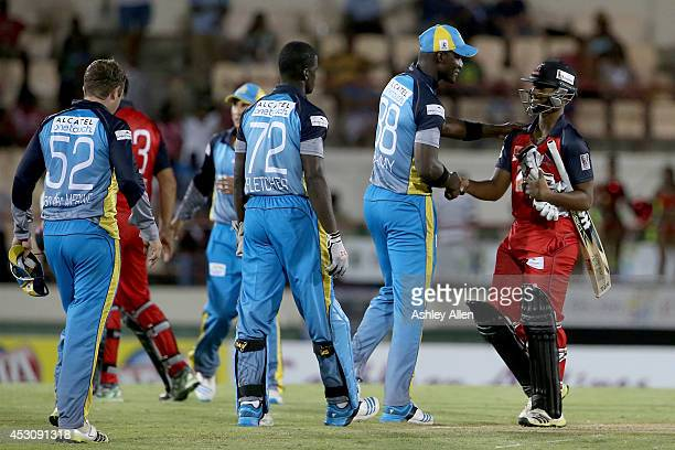 Darren Sammy of St Lucia Zoucks congratulates Nicholas Pooran of The Red Steel after loosing a match between The Red Steel and St Lucia Zouks as part...