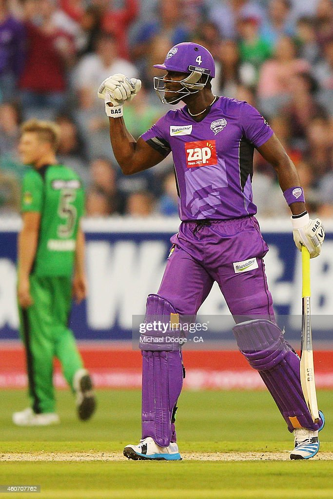 <a gi-track='captionPersonalityLinkClicked' href=/galleries/search?phrase=Darren+Sammy&family=editorial&specificpeople=2920912 ng-click='$event.stopPropagation()'>Darren Sammy</a> of the Hurricanes celebrates another six off Daniel Worrall of the Stars during the Big Bash League match between the Melbourne Stars and the Hobart Hurricanes at Melbourne Cricket Ground on December 20, 2014 in Melbourne, Australia.