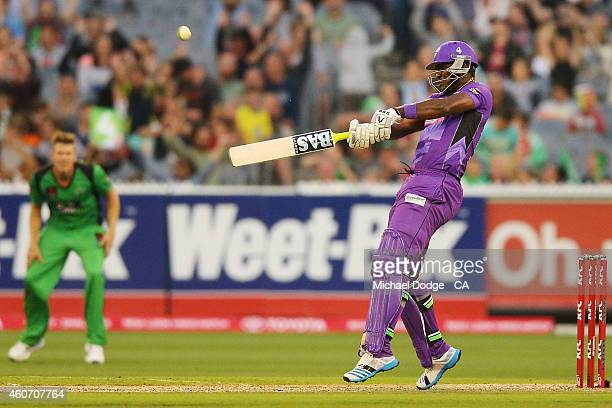 Darren Sammy of the Hurricanes hits a six off Daniel Worrall of the Stars during the Big Bash League match between the Melbourne Stars and the Hobart...