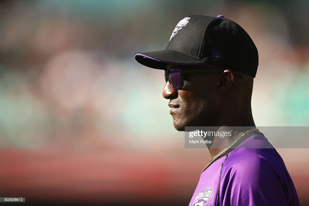 <a gi-track='captionPersonalityLinkClicked' href=/galleries/search?phrase=Darren+Sammy&family=editorial&specificpeople=2920912 ng-click='$event.stopPropagation()'>Darren Sammy</a> of the Hurricanes watches on during the Big Bash League match between the Sydney Sixers and the Hobart Hurricanes at Sydney Cricket Ground on December 20, 2015 in Sydney, Australia.