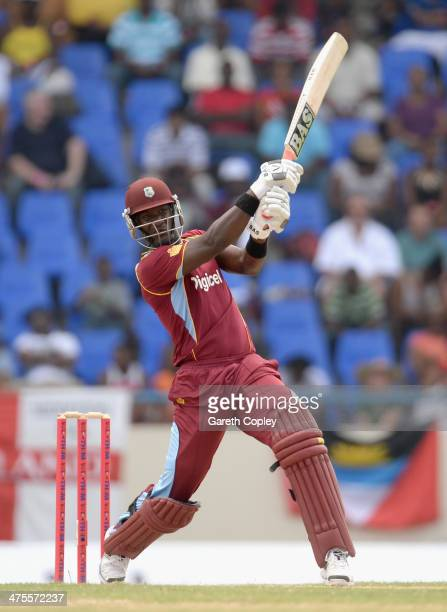 Darren Sammy of the West Indies bats during the 1st One Day International between West Indies and England at Sir Viv Richards Cricket Ground on...