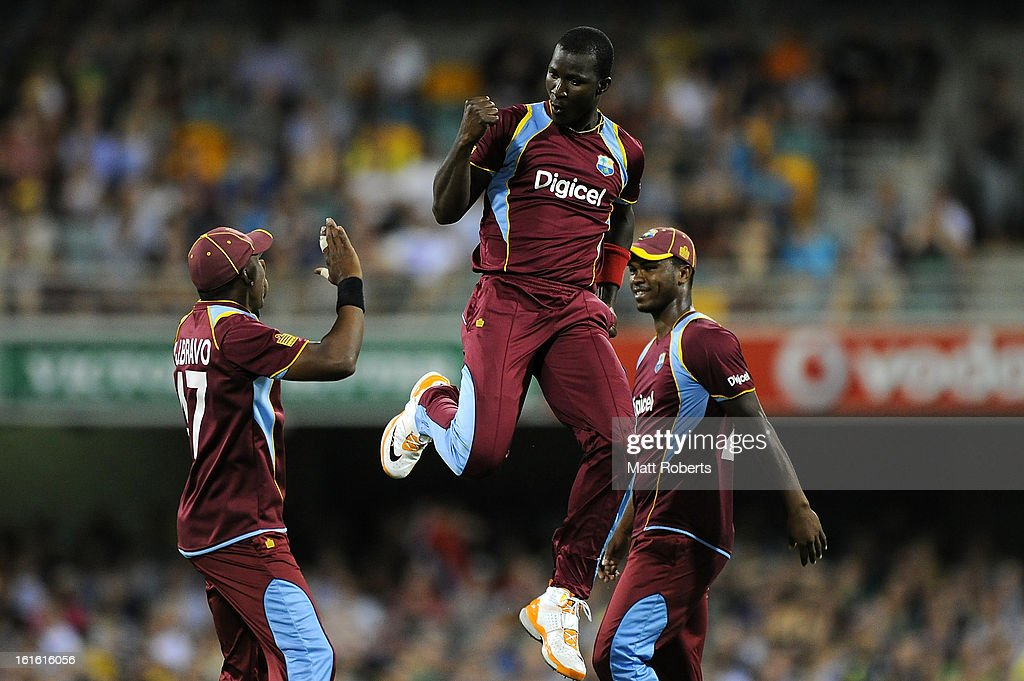 <a gi-track='captionPersonalityLinkClicked' href=/galleries/search?phrase=Darren+Sammy&family=editorial&specificpeople=2920912 ng-click='$event.stopPropagation()'>Darren Sammy</a> of the West Indies celebrates a wicket off his first delivery during the International Twenty20 match between Australia and the West Indies at The Gabba on February 13, 2013 in Brisbane, Australia.