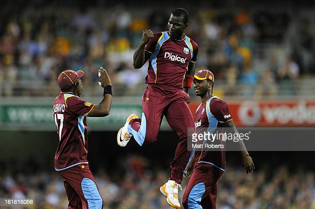 Darren Sammy of the West Indies celebrates a wicket off his first delivery during the International Twenty20 match between Australia and the West...