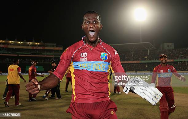 Darren Sammy of the West Indies celebrates hitting the winning runs to defeat Australia during the ICC World Twenty20 Bangladesh 2014 match between...
