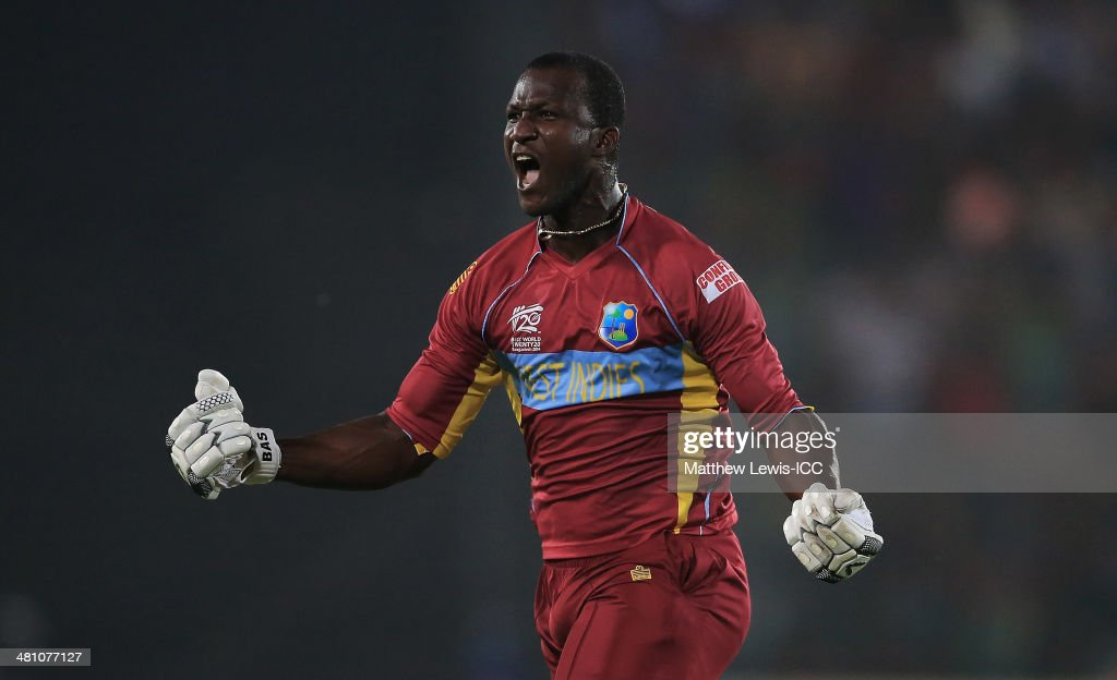 <a gi-track='captionPersonalityLinkClicked' href=/galleries/search?phrase=Darren+Sammy&family=editorial&specificpeople=2920912 ng-click='$event.stopPropagation()'>Darren Sammy</a> of the West Indies celebrates hitting the winning runs to defeat Australia during the ICC World Twenty20 Bangladesh 2014 match between the West indies and Australia at Sher-e-Bangla Mirpur Stadium on March 28, 2014 in Dhaka, Bangladesh.
