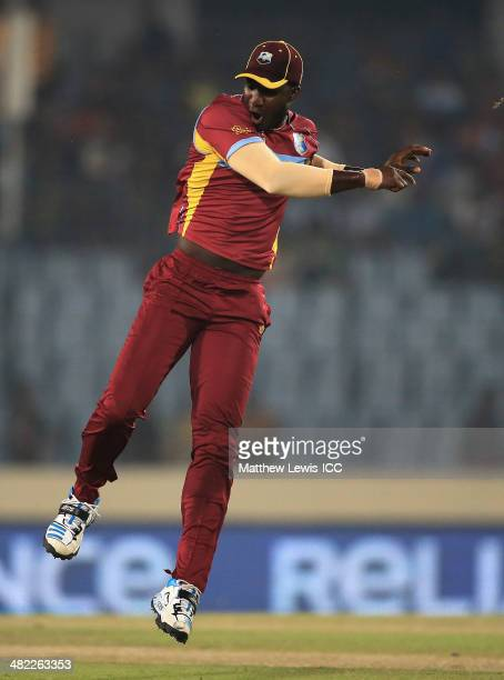Darren Sammy of the West indies celebrates running out Mahela Jayawardene of Sri Lanka during the ICC World Twenty20 Bangladesh 2014 Semi Final match...