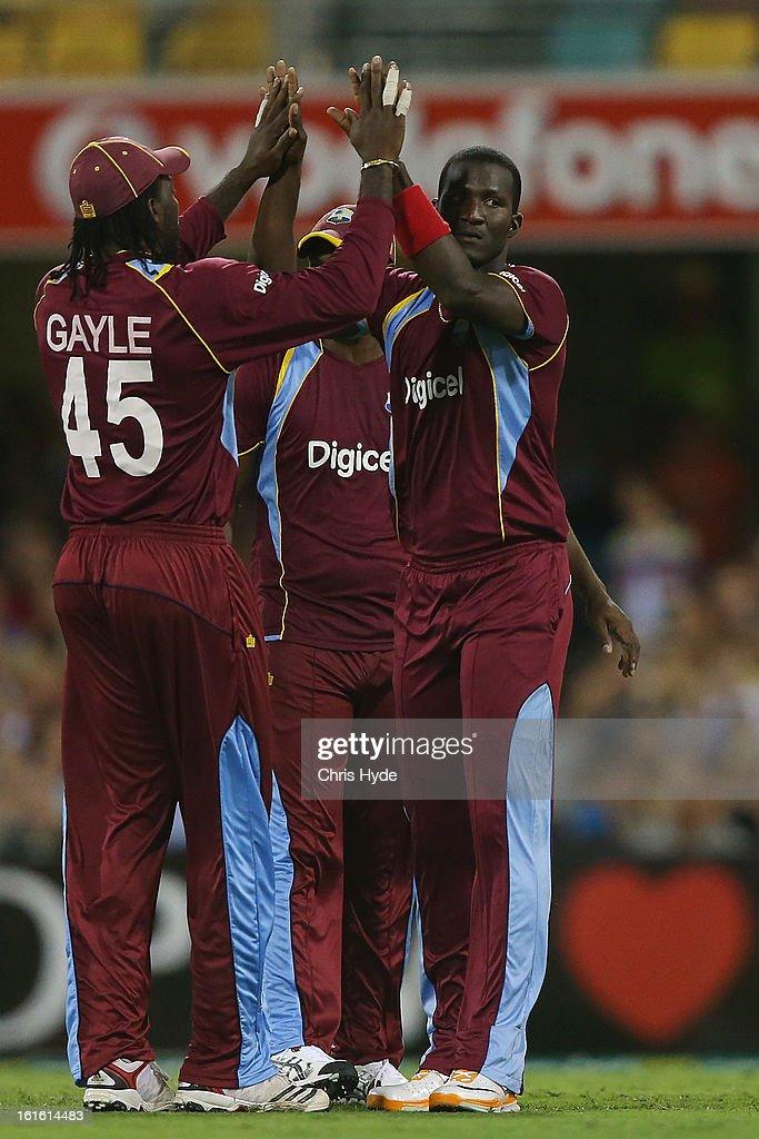 Darren Sammy of the West Indies celebrates with team mates after dismissing Aaron Finch of Australia during the International Twenty20 match between Australia and the West Indies at The Gabba on February 13, 2013 in Brisbane, Australia.