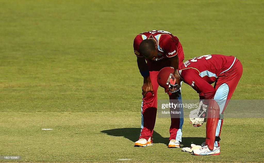 Darren Sammy of the West Indies checks on team mate Devon Thomas after he injured a finger during the Commonwealth Bank One Day International Series between Australia and the West Indies at Manuka Oval on February 6, 2013 in Canberra, Australia.