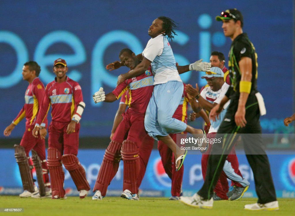 <a gi-track='captionPersonalityLinkClicked' href=/galleries/search?phrase=Darren+Sammy&family=editorial&specificpeople=2920912 ng-click='$event.stopPropagation()'>Darren Sammy</a> of the West Indies is congratulated by <a gi-track='captionPersonalityLinkClicked' href=/galleries/search?phrase=Chris+Gayle+-+Cricket+Player&family=editorial&specificpeople=206191 ng-click='$event.stopPropagation()'>Chris Gayle</a> and the rest of his teammates after hitting the winning runs as <a gi-track='captionPersonalityLinkClicked' href=/galleries/search?phrase=Mitchell+Starc&family=editorial&specificpeople=6475541 ng-click='$event.stopPropagation()'>Mitchell Starc</a> of Australia looks on during the ICC World Twenty20 Bangladesh 2014 match between Australia and the West Indies at Sher-e-Bangla Mirpur Stadium on March 28, 2014 in Dhaka, Bangladesh.