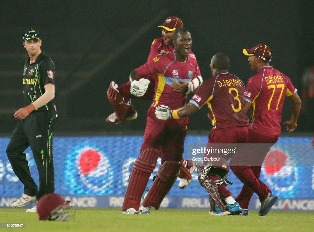 <a gi-track='captionPersonalityLinkClicked' href=/galleries/search?phrase=Darren+Sammy&family=editorial&specificpeople=2920912 ng-click='$event.stopPropagation()'>Darren Sammy</a> of the West Indies is congratulated by his teammates after hitting the winning runs as James Muirhead of Australia looks on during the ICC World Twenty20 Bangladesh 2014 match between Australia and the West Indies at Sher-e-Bangla Mirpur Stadium on March 28, 2014 in Dhaka, Bangladesh.