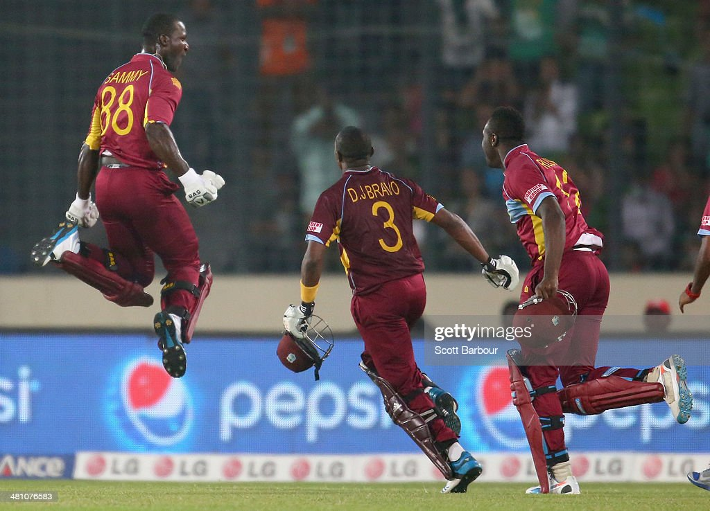 <a gi-track='captionPersonalityLinkClicked' href=/galleries/search?phrase=Darren+Sammy&family=editorial&specificpeople=2920912 ng-click='$event.stopPropagation()'>Darren Sammy</a> of the West Indies is congratulated by his teammates after hitting the winning runs during the ICC World Twenty20 Bangladesh 2014 match between Australia and the West Indies at Sher-e-Bangla Mirpur Stadium on March 28, 2014 in Dhaka, Bangladesh.