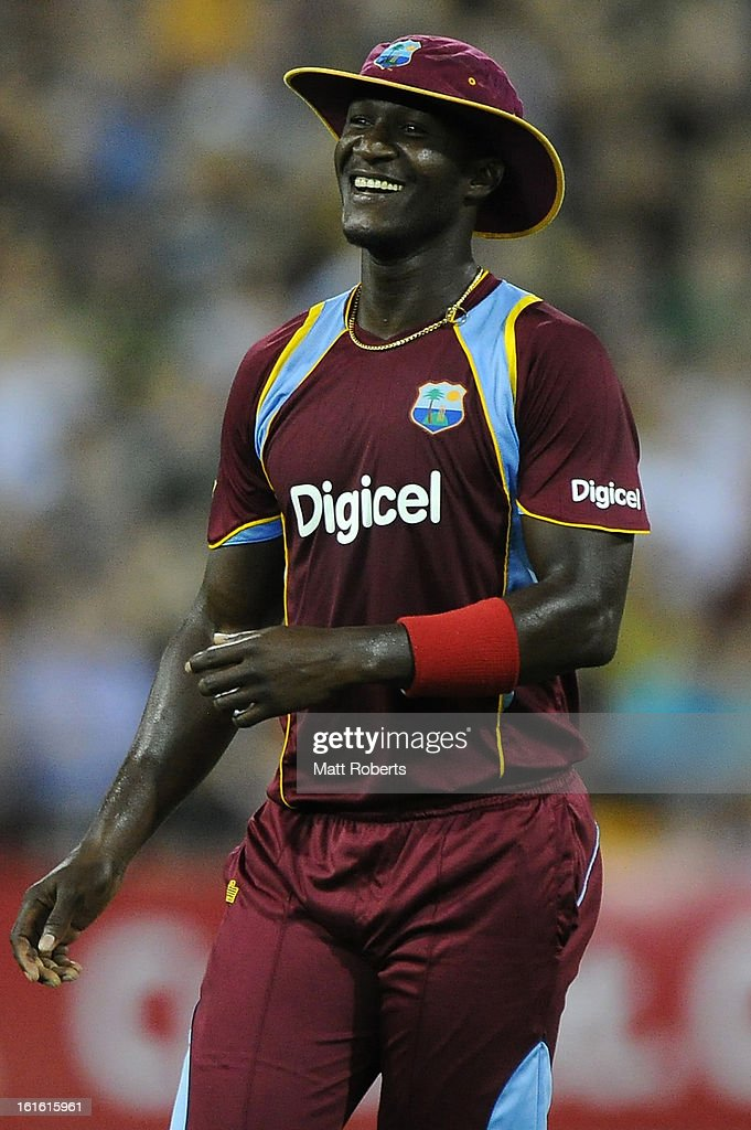 Darren Sammy of the West Indies smiles in the outfield during the International Twenty20 match between Australia and the West Indies at The Gabba on February 13, 2013 in Brisbane, Australia.