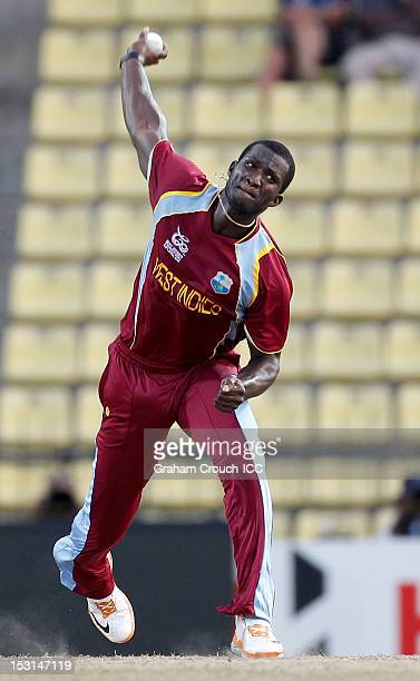 Darren Sammy of West Indies bowls during the Super Eights Group 1 match between New Zealand and West Indies at Pallekele Cricket Stadium on October 1...
