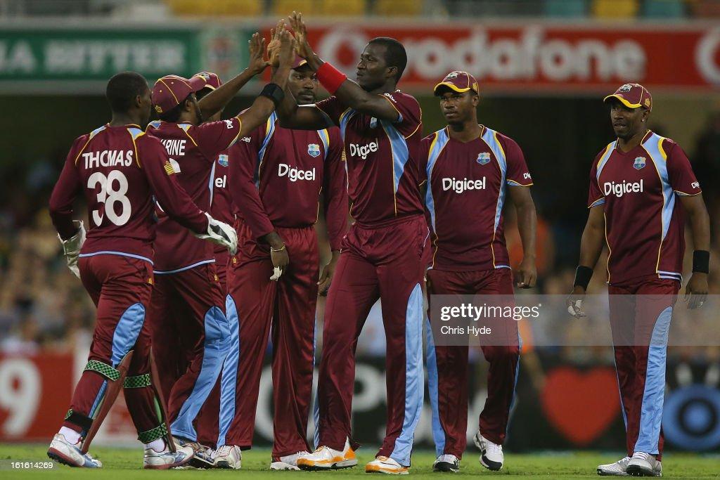 Darren Sammy of West Indies celebrates with team mates after dismissing Aaron Finch of Australia during the International Twenty20 match between Australia and the West Indies at The Gabba on February 13, 2013 in Brisbane, Australia.