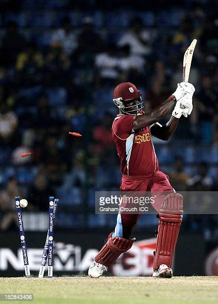 Darren Sammy of West Indies is bowled by Stuart Broad of England during the A1 versus B2 Super Eight match between England and West Indies at...