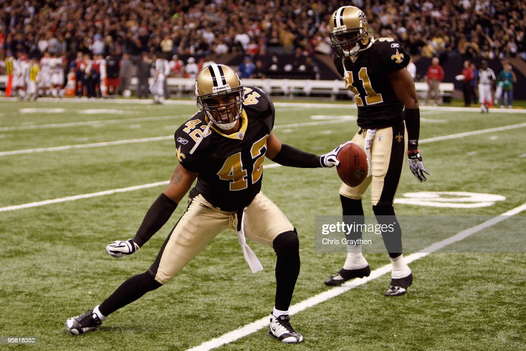<a gi-track='captionPersonalityLinkClicked' href=/galleries/search?phrase=Darren+Sharper&family=editorial&specificpeople=208733 ng-click='$event.stopPropagation()'>Darren Sharper</a> #42 and Roman Harper #41 of the New Orleans Saints celebrate after Sharper broke up a pass play against the Arizona Cardinals during the NFC Divisional Playoff Game at Louisana Superdome on January 16, 2010 in New Orleans, Louisiana.