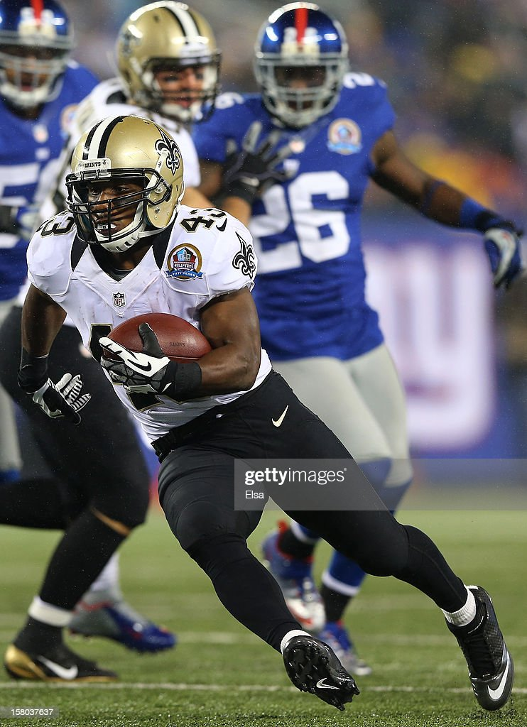 Darren Sproles #43 of the New Orleans Saints carries the ball in for a touchdown against the New York Giants on December 9, 2012 at MetLife Stadium in East Rutherford, New Jersey.