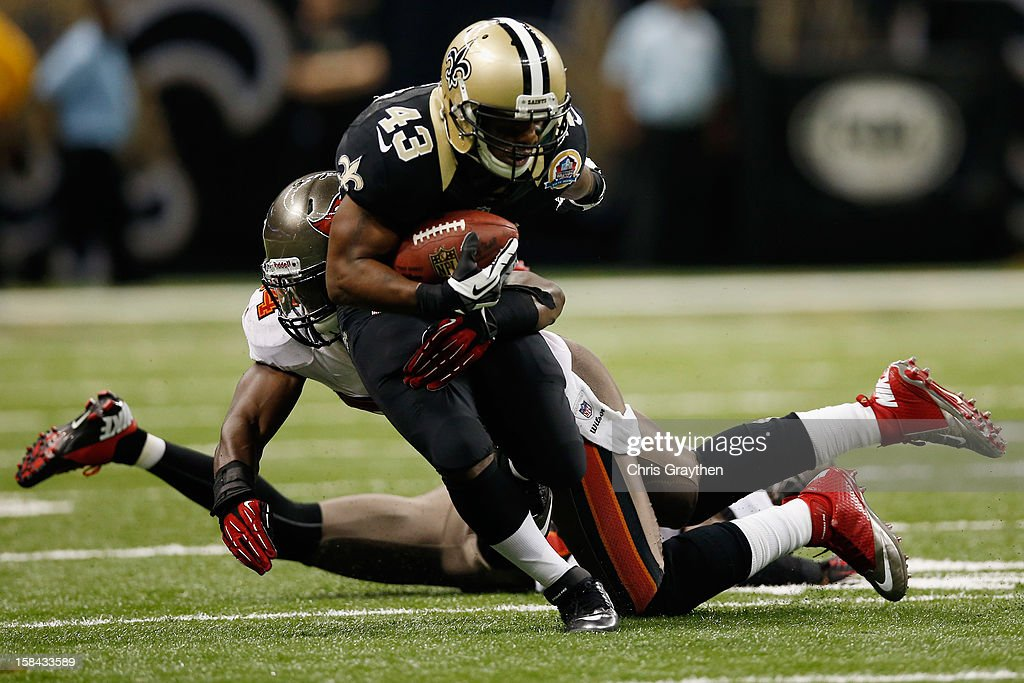 <a gi-track='captionPersonalityLinkClicked' href=/galleries/search?phrase=Darren+Sproles&family=editorial&specificpeople=583154 ng-click='$event.stopPropagation()'>Darren Sproles</a> #43 of the New Orleans Saints is tackled by <a gi-track='captionPersonalityLinkClicked' href=/galleries/search?phrase=Mark+Barron&family=editorial&specificpeople=2593511 ng-click='$event.stopPropagation()'>Mark Barron</a> #24 of the Tampa Bay Buccaneers at the Mercedes-Benz Superdome on December 16, 2012 in New Orleans, Louisiana. The Saints defeated the Buccs 41-0.
