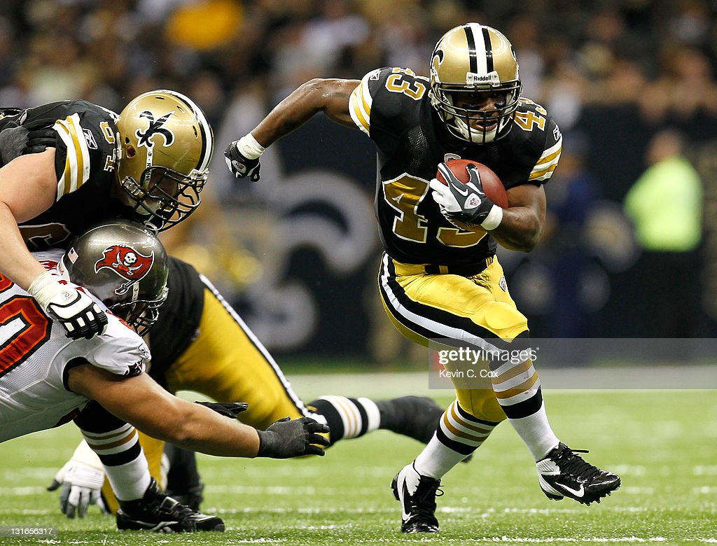 <a gi-track='captionPersonalityLinkClicked' href=/galleries/search?phrase=Darren+Sproles&family=editorial&specificpeople=583154 ng-click='$event.stopPropagation()'>Darren Sproles</a> #43 of the New Orleans Saints rushes against the Tampa Bay Buccaneers at Mercedes-Benz Superdome on November 6, 2011 in New Orleans, Louisiana.