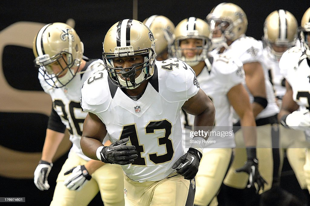 Darren Sproles #43 of the New Orleans Saints takes the field for warm-ups prior to a preseason game against the Oakland Raiders at the Mercedes-Benz Superdome on August 16, 2013 in New Orleans, Louisiana. The Saints won 28-20.