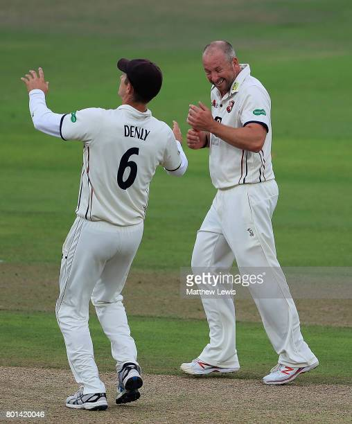 Darren Stevens and Joe Denly of Kent celebrate the wicket of Jakre Libby of Nottinghamshire after he was caught by Sean Dickson during the Specsavers...