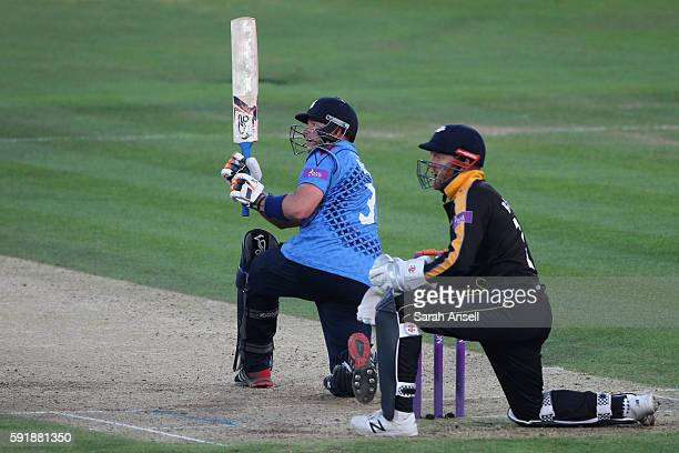 Darren Stevens of Kent hits a six as Yorkshire wicket keeper JonnynBairstow looks on during the Royal London OneDay Cup quarter final between Kent v...
