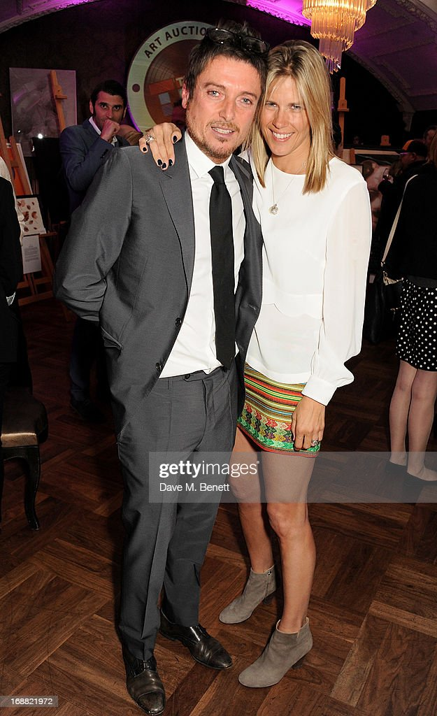 Darren Strowger (L) and Clare Strowger attend the annual fundraising art auction in aid of Teenage Cancer Trust at The Groucho Club on May 15, 2013 in London, England.