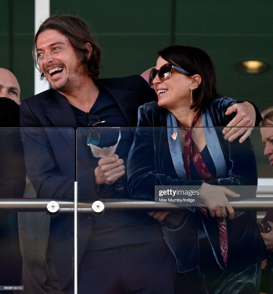 Darren Strowger and Sadie Frost watch the racing as they attend day 2 'Ladies Day' of the Cheltenham Festival at Cheltenham Racecourse on March 15, 2017 in Cheltenham, England.