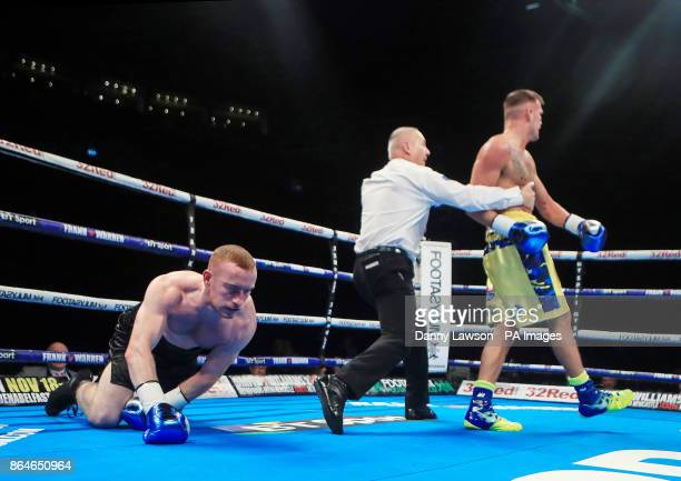 Darren Tetley knocks down Terry Needham during their Welterweight Contest at the First Direct Arena Leeds