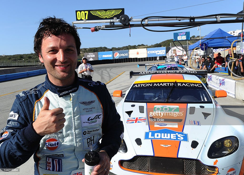 Darren Turner of England celebrates GT class pole position in the HackettLowes/Gulf Aston Martin Vantage during practice for the American Le Mans...