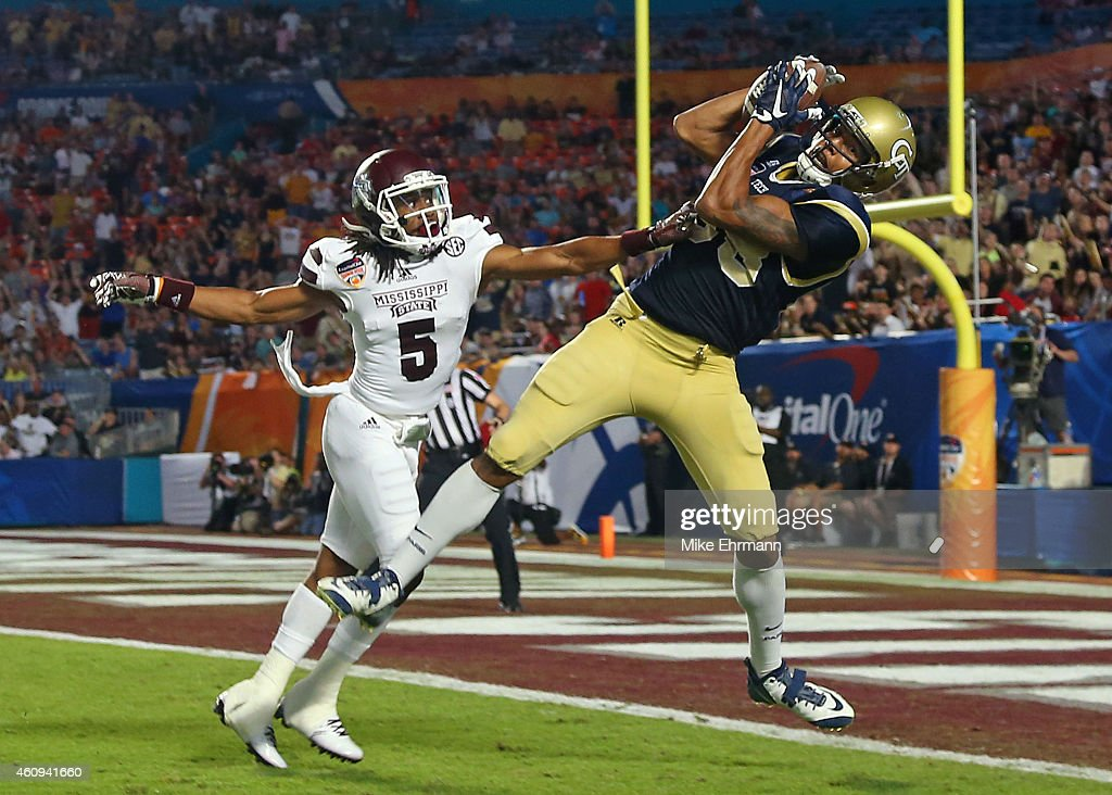 <a gi-track='captionPersonalityLinkClicked' href=/galleries/search?phrase=Darren+Waller&family=editorial&specificpeople=8583964 ng-click='$event.stopPropagation()'>Darren Waller</a> #88 of the Georgia Tech Yellow Jackets catches a touchdown pass over defender Jamerson Love #5 of the Mississippi State Bulldogs during the first half of the Capital One Orange Bowl game at Sun Life Stadium on December 31, 2014 in Miami Gardens, Florida.