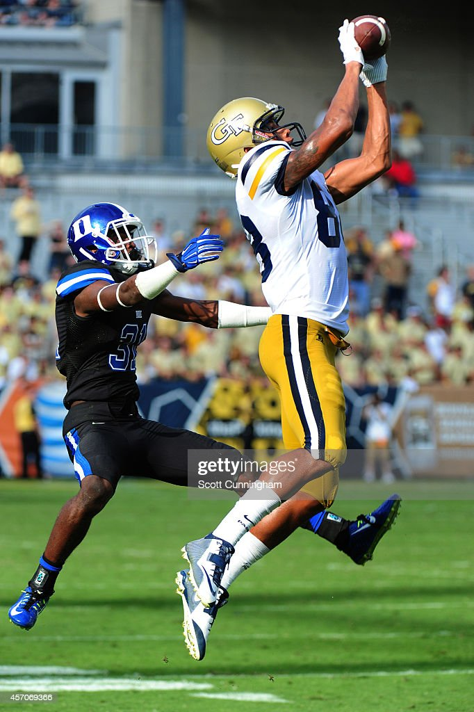 <a gi-track='captionPersonalityLinkClicked' href=/galleries/search?phrase=Darren+Waller&family=editorial&specificpeople=8583964 ng-click='$event.stopPropagation()'>Darren Waller</a> #88 of the Georgia Tech Yellow Jackets makes a catch against Breon Borders #31 of the Duke Blue Devils at Bobby Dodd Stadium on October 11, 2014 in Atlanta, Georgia.