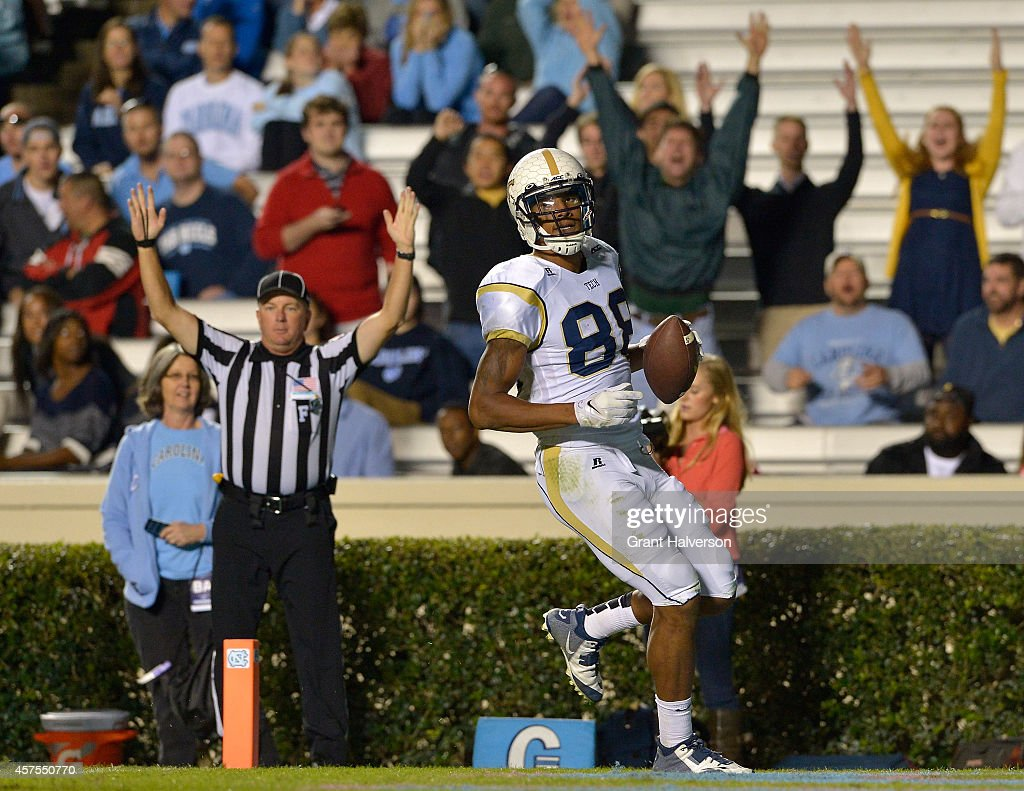 <a gi-track='captionPersonalityLinkClicked' href=/galleries/search?phrase=Darren+Waller&family=editorial&specificpeople=8583964 ng-click='$event.stopPropagation()'>Darren Waller</a> #88 of the Georgia Tech Yellow Jackets scores a touchdown against the North Carolina Tar Heels during their game at Kenan Stadium on October 18, 2014 in Chapel Hill, North Carolina. North Carolina won 48-43.
