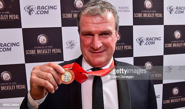 Darren Weir poses with his Fred Hoysted Medal at The Atrium on August 25 2016 in Flemington Australia