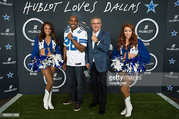 Darren Woodson and Ricardo Guadalupe pose for a photo with Dallas Cowboy cheerleaders as Hublot unveils the Big Bang Dallas Cowboys timepieces at ATT...