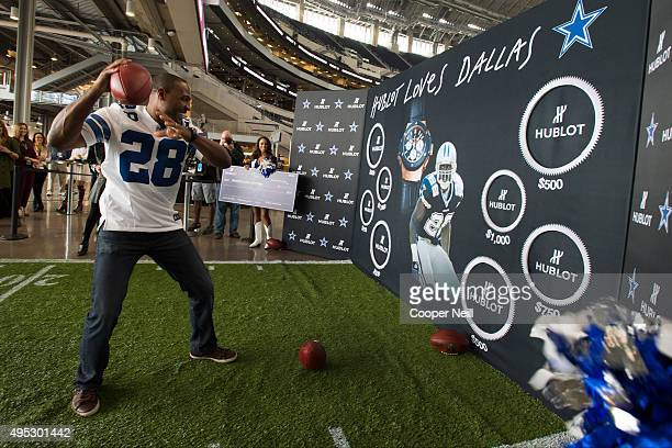 Darren Woodson competes in a football toss for charity as Hublot unveils the Big Bang Dallas Cowboys timepieces at ATT Stadium on November 1 2015 in...