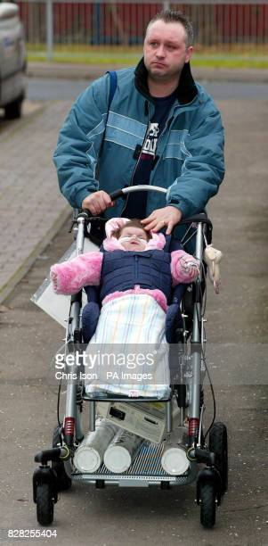 Darren Wyatt brings his severely disabled daughter Charlotte home for the first time Tuesday December 6 2005 Debbie Wyatt and husband Darren won a...