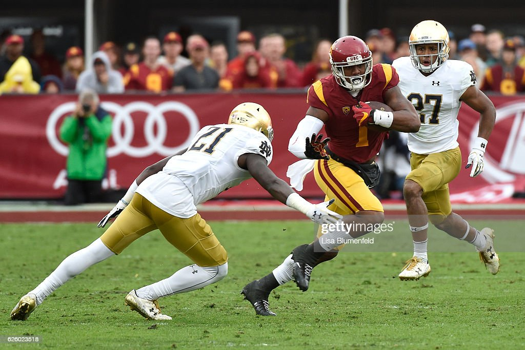 Darreus Rogers #1 of the USC Trojans advances the ball in the third quarter against (Left)Jalen Elliott #21 of the Notre Dame Fighting Irish at Los Angeles Memorial Coliseum on November 26, 2016 in Los Angeles, California.
