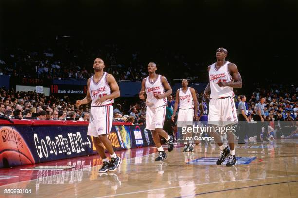 Darrick Martin Lorenzen Wright Bo Outlaw and Lamond Murray of the Los Angeles Clippers head to the bench during the game against the Utah Jazz on...