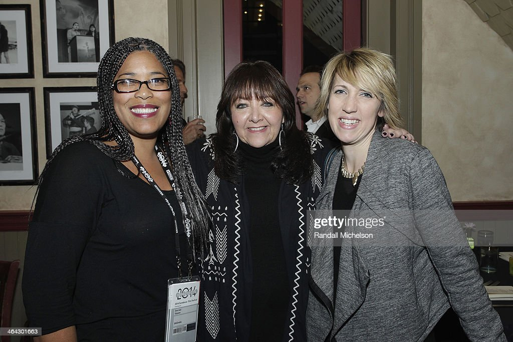 Darrien Michele Gipson Doreen RingerRoss and Amy Dotson attend the BMI Zoom dinner at Zoom Restaurant on January 21 2014 in Park City Utah